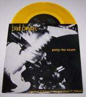 BAD BRAINS PAY TO CUM / AT THE MOVIES (YELLOW VINYL)